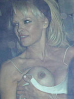 Pamela Anderson boobslip at Chateau Marmont