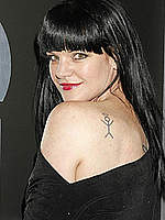 Pauley Perrette in black dress at Grammy