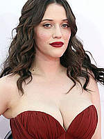 Kat Dennings shows deep cleavage in red dress